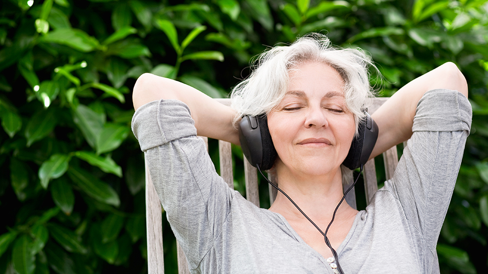 pfas-houston-summer-guide-woman-listening-to-music